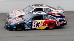 2010_Michigan_June_NSCS_Race_Casey_Mears_Scott_Speed_race_side-by-side