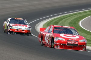 2010_Indianapolis_NSCS_Juan_Pablo_Montoya_leads_Greg_Biffle