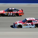 2010_Auto_Club_Oct_NSCS_race_Tony_Stewart_leads_Clint_Bowyer_HH