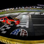 2010_Charlotte_Oct_NSCS_Jamie_McMurray_crosses_finish_line