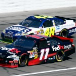 2010_Kansas_Oct_NSCS_Jimmie_Johnson_Denny_Hamlin_on_track