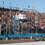 2010_Phoenix_Nov_NSCS_Carl_Edwards_crosses_finish_line