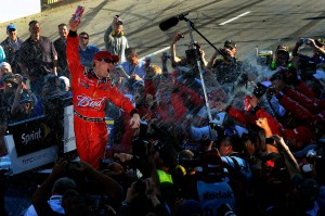 2011MartinsvilleApr_NSCS_Kevin_Harvick_climb_out_victory_lane