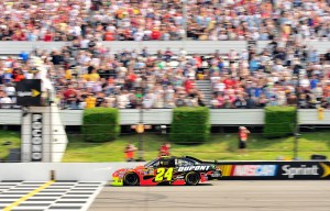 2011_Pocono_June_NSCS_Jeff_Gordon_crosses_finish_line