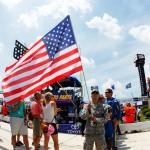 soldier-american-flag-nascar-flyover-dover-june-2012