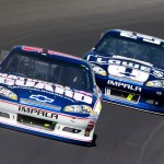 2012_Michigan_Aug_NSCS_Dale_Earnhardt_Jr_leads_Jimmie_Johnson