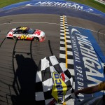 2012_Michigan_Aug_NSCS_Greg_Biffle_crosses_finish_line