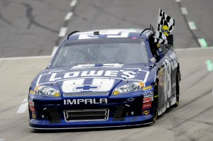 2012 Martinsville2 Jimmie Johnson Celebrates With Checkered Flag