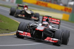 Jenson Button leads Romain Grosjean of Lotus F1