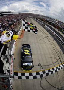 Tony-Stewart-checkered-flag-Dover-NASCAR-Fed-Ex-Autism-Speaks-400