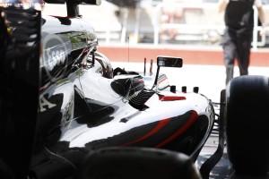 Jenson Button prepares to leave the garage.